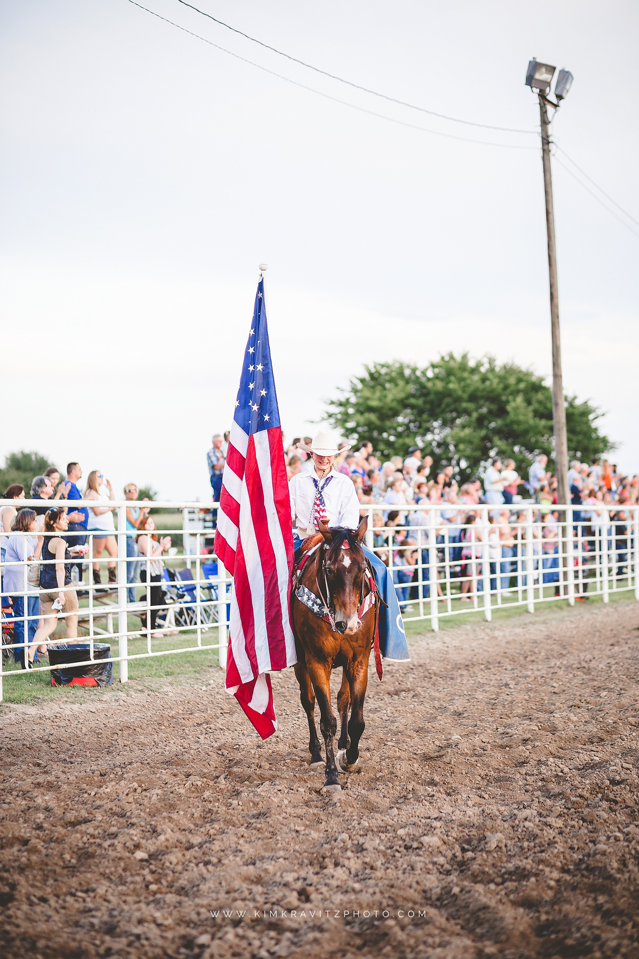 girl carrying old glory at the helper rodeo