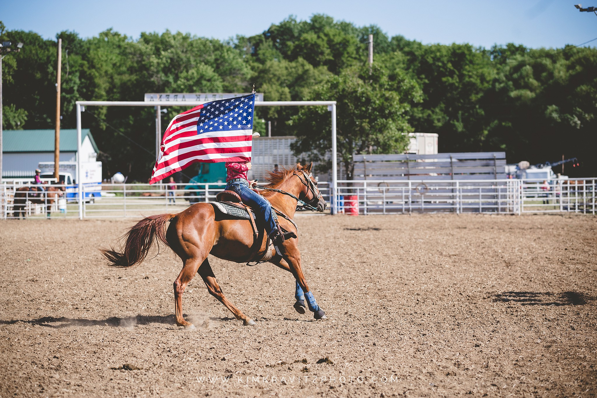 girl carrying flag on horse to start crawford county rodeo